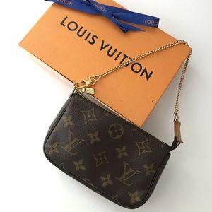 💯 Authentic Louis Vuitton mini Pochette